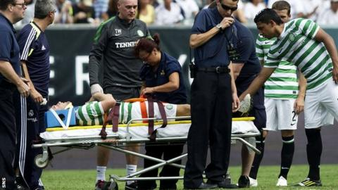 Celtic forward Dylan McGeouch left the field on a stretcher