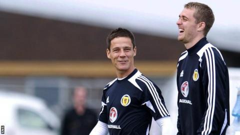Black shares a joke with Darren Fletcher during Scotland training