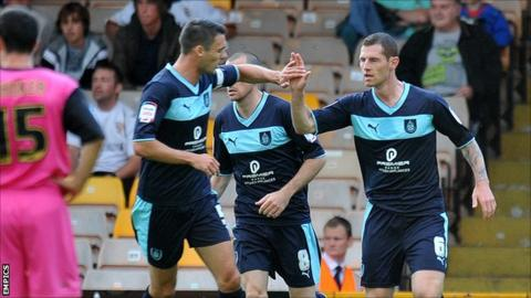 Burnley players celebrate Chris McCann's equaliser at Port Vale