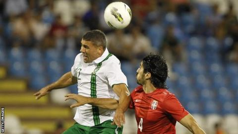 Jon Walters fight out an aerial duel with Milan Bisevac