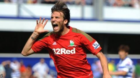 Michu celebrates after putting Swansea ahead