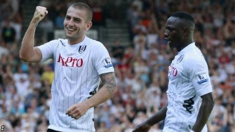 Mladen Petric (left) celebrates scoring for Fulham on his debut