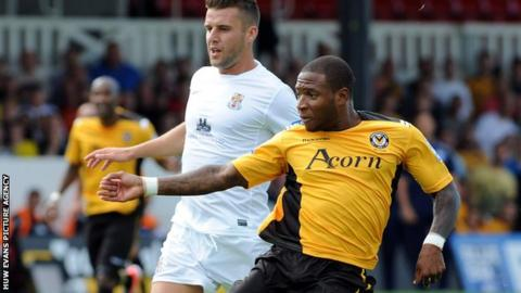 Aaron O'Connor scoring Newport's first goal against Lincoln