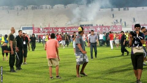 Etoile du Sahel fans invade the pitch during the 2-0 defeat by Esperance