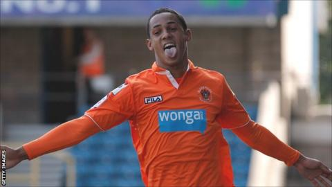 Blackpool winger Tom Ince celebrates one of his two goals at Millwall on Saturday
