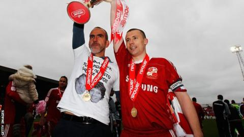 Paolo Di Canio and Paul Caddis lift the League Two trophy