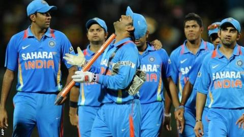 """Indian cricket team captain Mahendra Singh Dhoni (C) celebrates with teammates his team""""s victory in the Twenty20 match between Sri Lanka and India"""