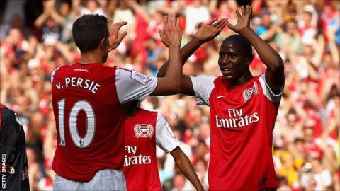 Robin van Persie and Benik Afobe celebrate a goal for Arsenal