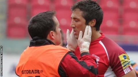 Gavin Henson receives treatment at Parc y Scarlets