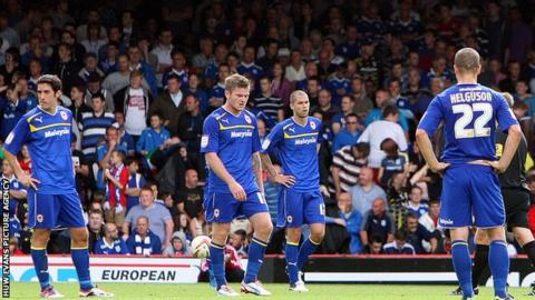 Cardiff City players dejected after losing to Bristol City