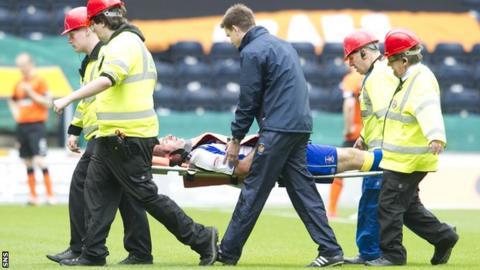 Gary Harkins is taken off on a stretcher