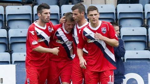 Ross County celebrate Richard Brittain's (second from left) penalty winner