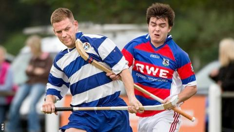 Newtonmore's Norman Campbell and Ryan Borthwick of Kingussie compete in their Orion Premiership match