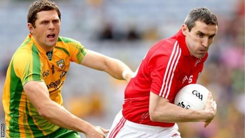 Ryan Bradley of Donegal gives chase to Cork opponent Graham Canty at Croke Park
