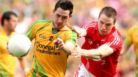 Mark McHugh moves clear of Colm O'Neill