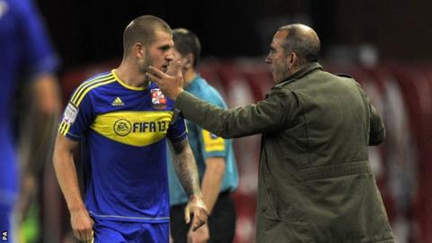 James Collins (left) and Swindon boss Paolo Di Canio