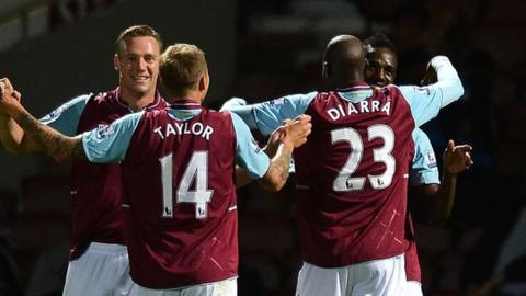 Modibo Maiga is congratulated by West Ham team-mates after scoring against Crewe