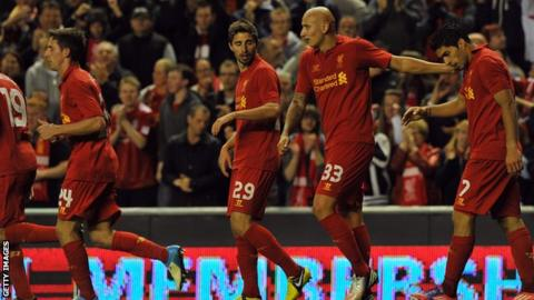 Luis Suarez (right) scored Liverpool's equaliser at Anfield