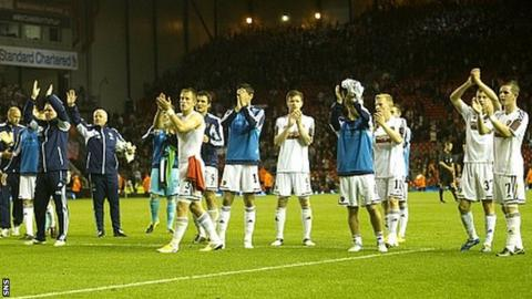 Hearts players applaud their supporters at Anfield