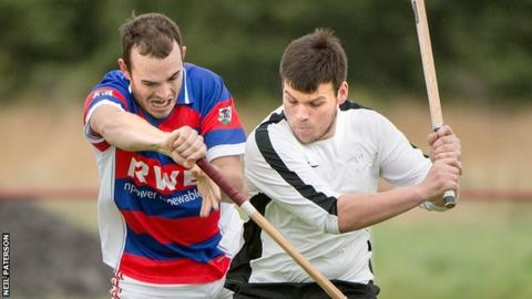 Lee Bain of Kingussie in action with Lovat's Greg Matheson in the Orion Premiership at The Dell