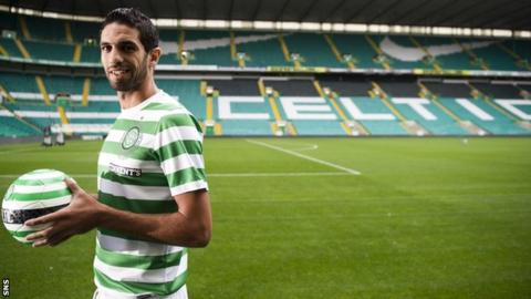 Lassad Nouioui tries on his new strip at Celtic Park