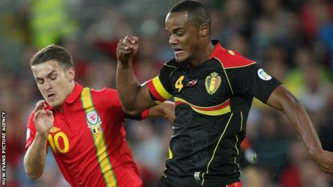 Wales captain Aaron Ramsey challenges Belgium captain Vincent Kompany