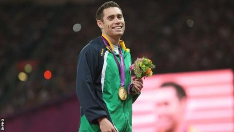 Jason Smyth smiles after being presented with his second London Paralympics gold by Lord Coe