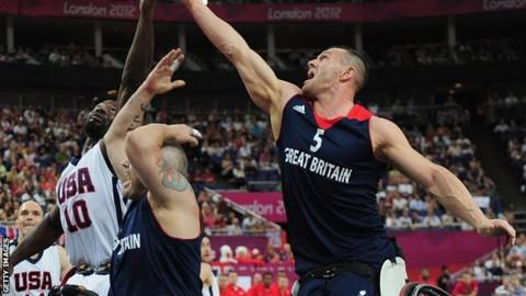 GB's Dan Hitchcock and Abdi Jama of USA reach for the ball during their bronze medal match