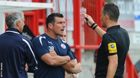 Crawley manager Richie Barker speaks to referee Darren Deadman