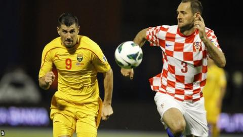 """Macedonia""""s Stevica Ristic (left) in action against Croatia"""