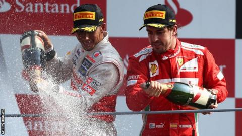 Lewis Hamilton (left) and Fernando Alonso after the Italian GP