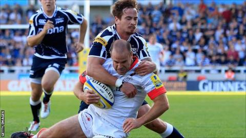 Danny Cipriani tackles Charlie Hodgson during Sale's defeat to Saracens on Saturday