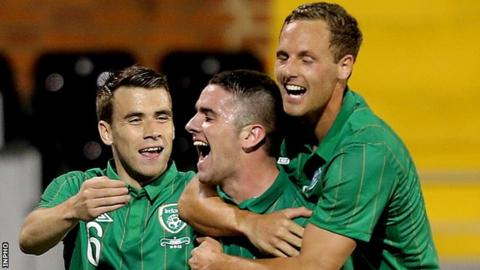 Robbie Brady (centre) celebrates after hitting the Republic's second goal at Craven Cottage