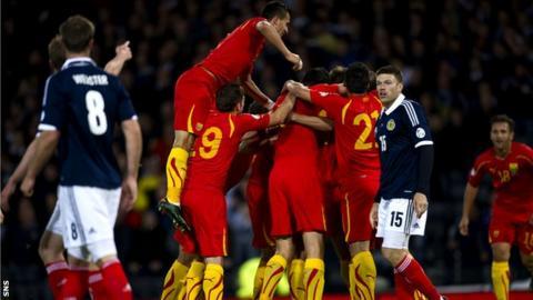 Macedonia celebrate Nikolce Noveski's goal that put Scotland behind at Hampden