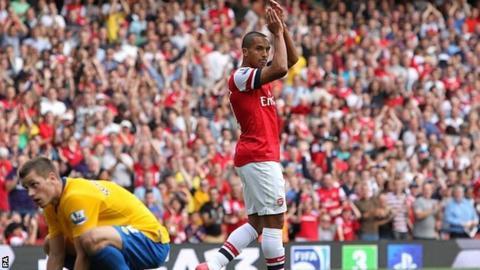 Theo Walcott celebrates scoring against former club Southampton