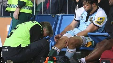 Ben Foden receives treatment after suffering an ankle injury