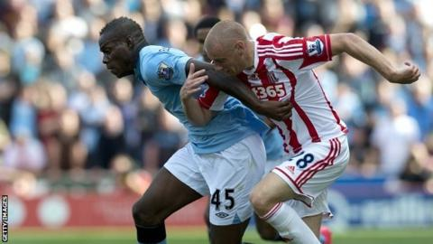 Mario Balotelli and Andy Wilkinson