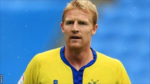 Bury defender Adam Lockwood