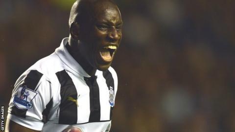 Demba Ba celebrates his late equaliser against Everton