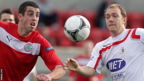 Joe Gormley of Cliftonville in action against Portadown's Ross Redman