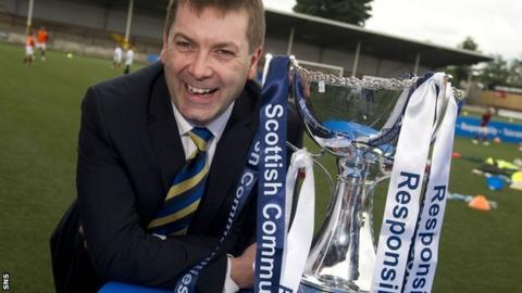 SFL chief executive David Longmuir with the Scottish Communities League Cup