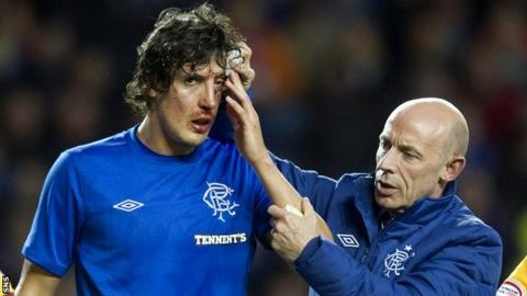 Rangers forward Francisco Sandaza receives treatment on an injury