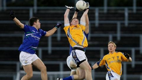 St Gall's player Niall O'Neill challenges Patrick McBride for the high ball in the final