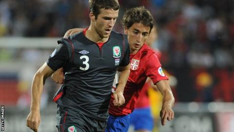 Matthews in action with the Wales team that lost 6-1 in Serbia