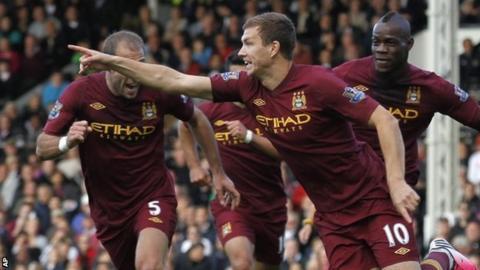 Edin Dzeko celebrates after scoring Manchester City's winner