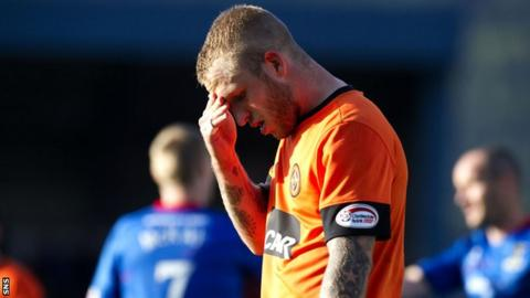 Dundee United striker Johnny Russell looks distraught at Caledonian Stadium