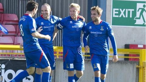 Richie Foran (second from right) celebrates with teammates after scoring his second goal for Inverness