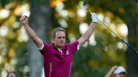 Europe's Luke Donald celebrates on the 17th tee