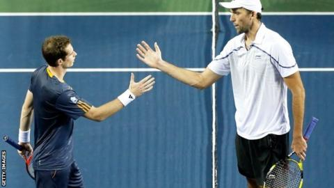 Andy Murray (left) defeats Ivo Karlovic in Japan