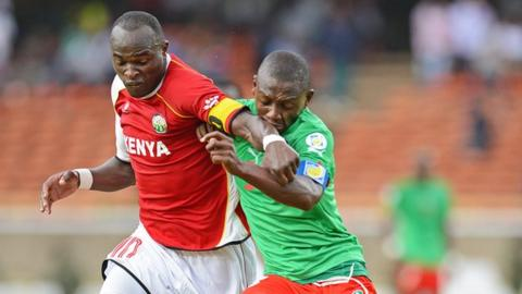 Denis Oliech of Kenya (left)